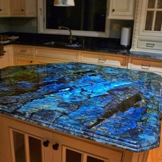 Goodmorning beauties Have some Labradorite for your viewing pleasure this morning in the form of an entire kitchen countertop! Literally im going to decorate my entire house in crystal furniture it is now a mission! Auctions will be coming Design Seeds, Crystal Furniture, Outdoor Kitchen Countertops, Soapstone Kitchen, Kitchen Cabinetry, Cabinets, Foyers, Interior Paint Colors, Purple Interior