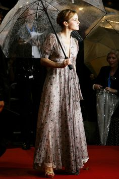 The Emma Watson Guide To Etiquette #refinery29  http://www.refinery29.com/2014/04/66323/emma-watson-red-carpet-pics#slide8  An umbrella is not a hindrance. It is a vehicle to enhance your natural glow.