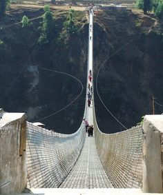 Kusma-Gyadi Bridge, Nepal - this huge catenary suspension footbridge is one of the world's highest of its type. Crossing 384 feet mtrs) above the Madi River, the trail bridge is also one of Nepal's longest with a span of feet mtrs). Places Around The World, The Places Youll Go, Places To See, Around The Worlds, What A Wonderful World, Beautiful World, Beautiful Places, Amazing Places, Amazing Things