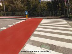 realizzazione pista ciclabile in vernice rossa e attraversamento ciclopedonale - segnaletica orizzontale