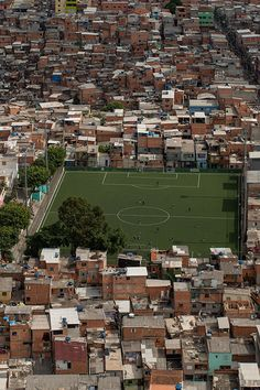That's Brazil. Poor houses, perfect soccer fields.