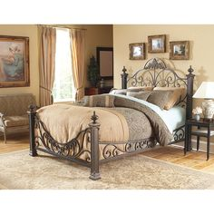 Sleep like royalty on this Baroque-style king-size bed. Built of solid steel with a tasteful gilded slate finish, this stately four-poster bed features elaborate decorative metalwork from headboard to