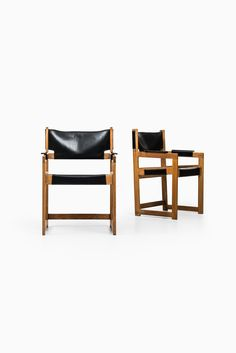 Sven Kai Larsen armchairs in oak and leather at Studio Schalling