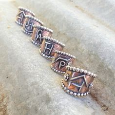 Copper custom livestock brand rings by The Classy Trailer On FB and Instagram @theclassytrailer