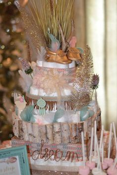 Boho chic baby shower party diaper cake! See more party planning ideas at CatchMyParty.com!