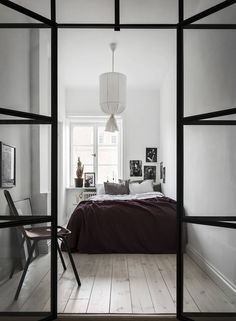 Bedroom with industrial glass wall