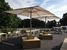 Installation of two 3m jumbrellas with bespoke seating at the Lawns Hull