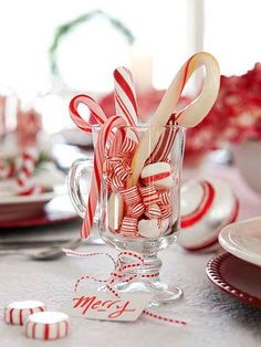 Sweet Treats: Gather an assortment of thrift store glasses and fill them with candy canes and other red-and-white striped candies to use as decor and to give as favors. Footed glasses, such as Irish coffee glasses, cordials, champagne flutes, and sherbet dishes, work best. #christmas