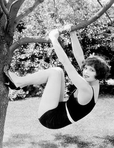 Clara Bow swings from a tree...