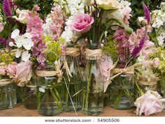 stock photo : close up image of flower arrangements in jam jarsshutterstock.com