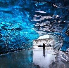 Bundle up and explore the crystal ice caves of Skaftafell, Iceland.