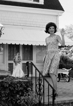 Jacqueline Kennedy and little Caroline waving to the cameras.