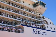 The senior officers came to the stage while the hundreds of other crew members emerged onto Riviera's verandas to a an exuberant round of applause.