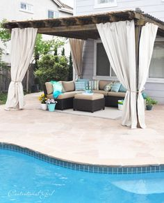 pergola with outdoor canvas panels - diy with painter's drop cloths and gromets