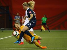 Korea Republic goalkeeper Kim Jungmi, left, makes a save against France midfielder Amandine Henry during the first half in the round of sixteen in the FIFA 2015 women's World Cup soccer tournament at Olympic Stadium.   Jean-Yves Ahern, USA TODAY Sports
