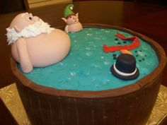 Santa and elf in Hot tub with what's left of Frosty.