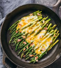 Baked asparagus is a delicious roasted side dish with lots of cheddar cheese and crispy bacon. This is an incredibly easy dish to make in under 30 minutes.
