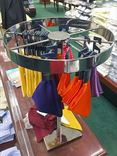 Pocket Square Retail Round-About – Fixtures Close Up - This Table-Top Carousel allowed presentation of various color Pocket Squares and Handkerchiefs by c - Handkerchiefs, Pocket Squares, Carousel, Display, Presentation, Retail, Merchandising Ideas, Colors, Rounding