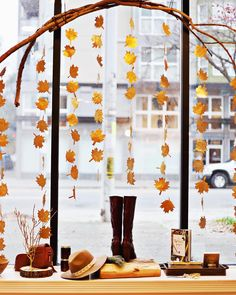 How gorgeous is this new window display by our sales associate and stylist She hand painted and cut all of those leaves, and the branches are from our operations managers beautiful big back yard. Shop all of the Thanksgiving inspired. Fall Store Displays, Store Window Displays, Shop Displays, Display Window, Halloween Window Display, Autumn Window Display Retail, Autumn Displays, Boutique Window Displays, Charity Shop Display Ideas