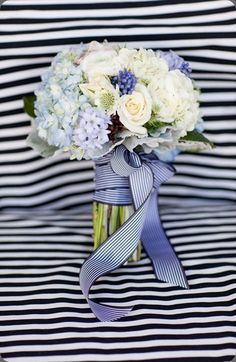 blue bouquet with striped ribbon