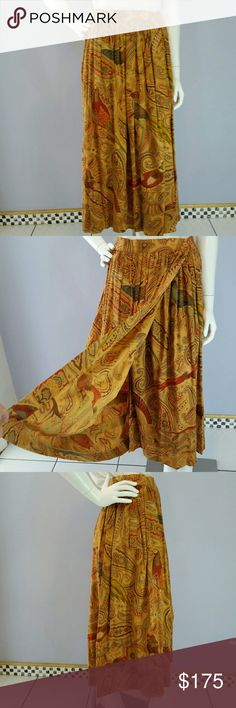 Vintage Escada Cotton Wrap Autumnal Skirt Sz 38 This is a Vintage Couture Escada Wrap Skirt in 100% Cotton. It features Autumn Colors in a Paisley Pheasant Print. Wraps and closes using two Escada Monogramed Buttons on the waistband (extra button included) has a slash pocket on either side, three tiers to the bottom of the skirt (see pics) and soft gathers at the waist give the skirt its fullness. Was purchased to coordinate with Escada Sweater I have listed. Happy to provide…