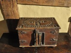 CHESTS / COFFERS - THE TOP CARVED WITH AN OVAL KNULL CARVED CENTRE WITH A CROWNED TOP FLANKED BY FEB 3 AND THE FOUR CORNERS DATED CLOCKWISE 1608, WITH CENTRAL HAMMER AND S DECORATION. THE FRONT WITH A HEAVY IRON LOCK AND HASP, THE KEY PLATE WITH A SECRET RELEASING MECH