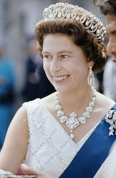 These ornate diamond frames, each containing an oval pearl drop, are the Duchess of Glouce...