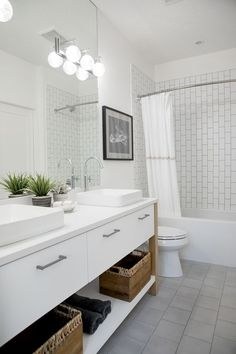 white themed bathroom with white shower tile and double sinks Modern Farmhouse Interiors, Modern Farmhouse Style, Farmhouse Design, Modern Barn, Farmhouse Plans, Ceiling Paint Colors, Bleached Wood, Jack And Jill Bathroom, Kitchen Cabinetry