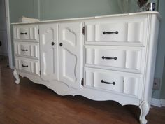 Purposedly Reinvented's fabulous furniture makeover.  I would do a different color and hardware for sure!!!