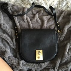 J Crew Crossbody Black with gold hardware, only wear is the front button J. Crew Bags Satchels