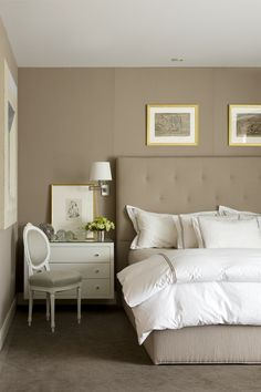 Neutral bedroom. Tufted headboard and crisp white linens. Feels modern with traditional elements.