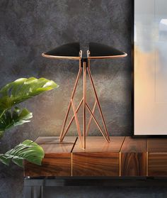 Beetle Table Lamp borrows the name from the living creature, so it is easy to see why. With the natural power to reinvigorate Beetle belongs to placid and simplistic interior design spaces #creativemary #tablelamp #interiordesign #interiordesigntrends #trends #inspiration #contemporarylighting #lightingdesign #lightingdesigner #luxurylighting #handcraftedlighting #moderndesign #handmadefurniture #moderninteriordesign #decorgoals #interiordesignideas #decorationideas #homedecor