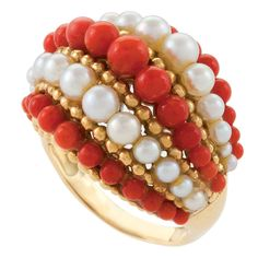 VAN CLEEF & ARPELS Coral Pearl Ring. The ring is set with alternating rows of pearls, corals and gold beads in a bombe shape. This ring was made with various hard stones, coral, lapis, or green agate. Circa. 1963.