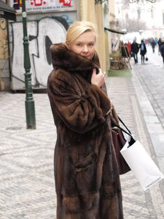 Nice blonde lady wrapped in one of Her mink coats. I know Her many years,still great!