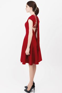 Guaranteed to garner lots of attention and admiring glances, this dress is a novel twist on the cocktail party dress. Modish lacing and a flattering silhouette tells the tale of a progressive outfit.