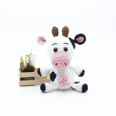 """Free crochet pattern on small crochet cow. Can be used for a crocheted song case for the children's songs """"Jens Petersen's cow"""" or """"Jens Hansen had a farm"""". Small crocheted cow KreaLoui KreaLoui Hæklet sangkuffert Free crochet pattern on sm Crochet Cow, Crochet Animals, Diy Crochet, Baby Knitting Patterns, Crochet Patterns, Granny Stripes, Mobiles, Iphone 6 Covers, Diy For Kids"""