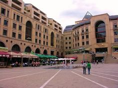 Information on Nelson Mandela Square attraction in Sandton brought to you by Gauteng Conference Centre conference venue in Midrand Provinces Of South Africa, Nelson Mandela, Honey, Milk, Street View, African, The Incredibles, Architecture, Heart