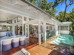 """I found this family beach home for sale in Avalon, NSW (a northern beachside suburb of Sydney). Those ceilings drew me in instantly! """"A seminal 'Pavilion' design by acclaimed architect Walter Barda, this extraordinary single level residence has been created with a modern interpretation of the classic Queenslander. Its result is a grand space with an unmatched indoor/outdoor connection and a direct north aspect."""" – Agent. The home is 3 bedroom, 2 bathroom with gorgeous plantation shutters…"""