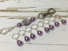 "If you take your knitting everywhere you go then this stitch marker lanyard is a ""must have"". It attaches to your project bag and allows you to keep those trusty stitch markers from ending up at the b"