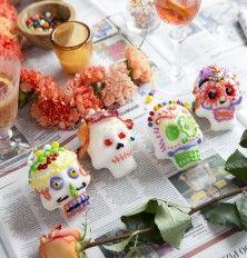 decorating sugar skulls for dia de los muertos