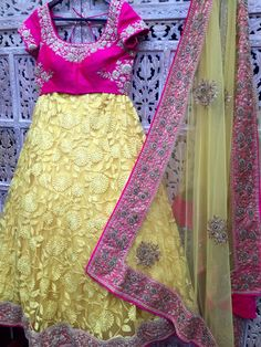 Riiti Fashions - San Jose, CA, United States. Lemon yellow lehenga with hot pink blouse paired with yellow tulle dupatta and pink border.Hand embroidered. Custom colors/orders available. contact www.riitifashions.com 1-408-368-8486
