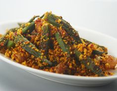 Okra: How to make Spicy Bhindi Andhra Style -Small whole ladysfingers cooked with a spicy Andhra style masala North Indian Recipes, South Indian Food, Indian Food Recipes, Vegetarian Cooking, Vegetarian Recipes, Cooking Recipes, Vegetarian Curry, Cooking Turkey, Veg Dishes