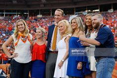 Peyton Manning poses with Annabel Bowlen and other members of the Bowlen family before the Denver Broncos take on the Carolina Panthers at Sports Authority Field at Mile High on September 8, 2016 in Denver, Colorado.