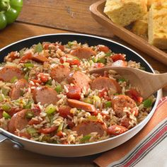 Fully Loaded Jambalaya with Andouille Sausage Recipe Main Dishes with Uncle Ben's® Ready Rice® Original Long Grain, Johnsonville Andouille, vegetable oil, onions, green bell pepper, celery, cajun seasoning, garlic, chopped tomatoes