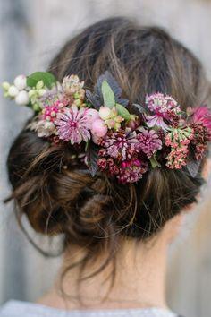 Add some gorgeous fresh flowers to your already stunning bridal updo. #ultimatebridalbeauty #weddinghair #bridalhair #weddingflowers