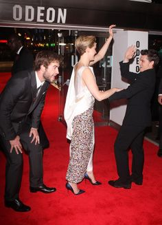 Josh is being attacked by Jennifer and liam is laughing his ass off this is the most beautifulest picture ever