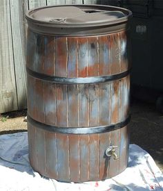 ~Rain barrel painted to look less, well industrial blue.  Great Idea