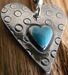 It's a heart, it's a shade of blue, and it has an old, handmade look...it's all good!