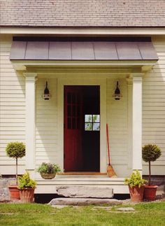 This is the perfect treatment for a secondary entrance to a house (this leads to a mudroom off the kitchen), The modest portico still shelters the entrance from the weather but because of the simple and clean treatment you would not confuse this with the front door.