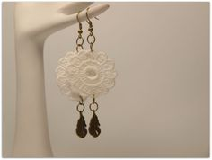 """These white doily lace trim vintage style earrings with small antique bronze/brass feather charms are simply beautiful and lightweight to wear, and will brighten up any outfit.  The earrings are approximately 3.35"""" (8.5 cm) in height (including hooks). The doily lace embellishment measures 33 m..."""